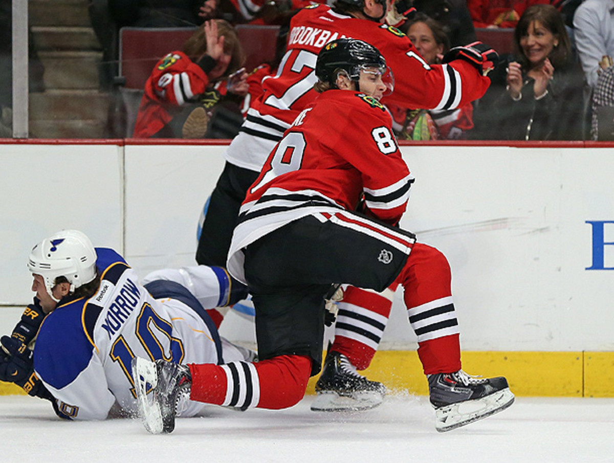Patrick Kane of the Chicago Blackhawks got his legs tangled up with Brenden Morrow in the second period. (Jonathan Daniel/Getty Images)