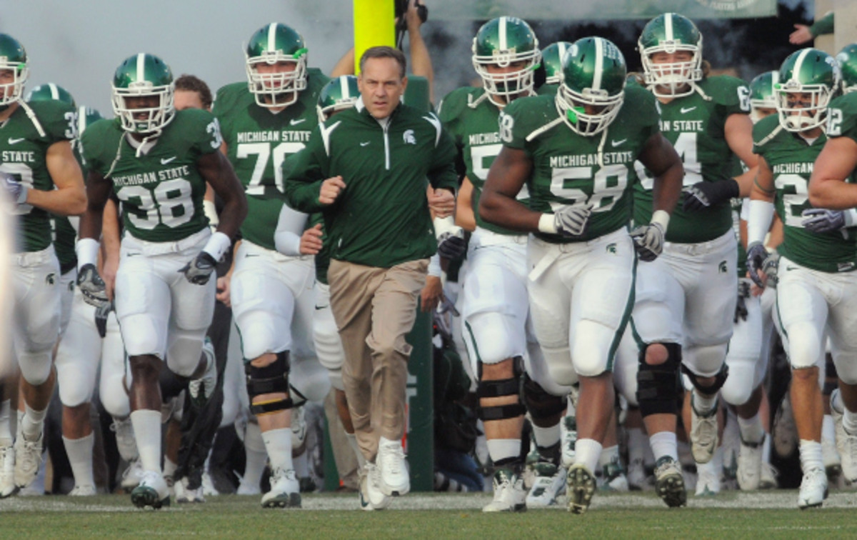 Mark Dantonio led the Spartans to a Big Ten Championship in 2013.  (Mark Cunningham/Getty Images)