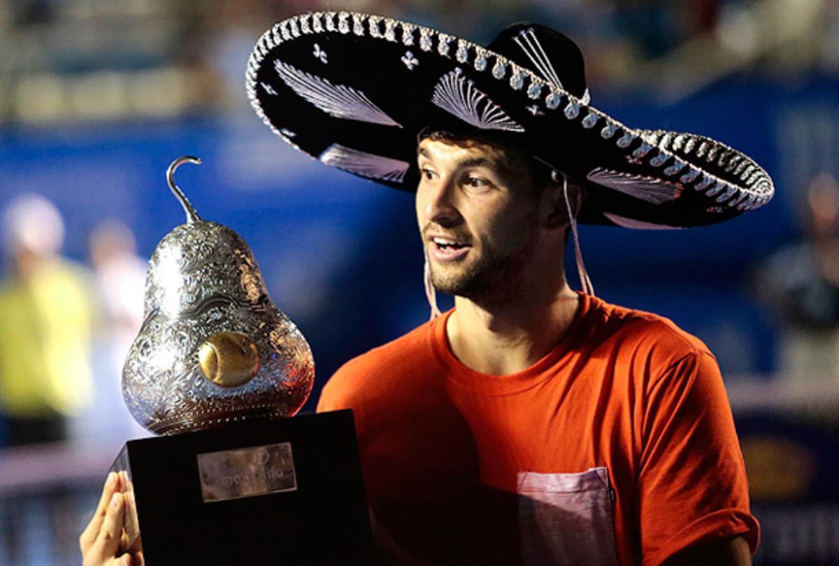 Grigor Dimitrov rocks a sombrero after winning the Mexican Open. (Pedro Pardo/AFP/Getty Images)