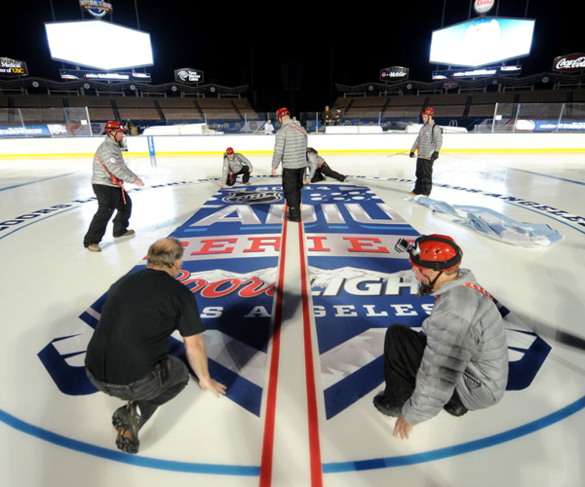 NHL Senior Director of Facilities Operations Dan Craig and members of his ice crew prepare the ice for the upcoming game between the Los Angeles Kings and the Anaheim Ducks at Dodger Stadium on January 20, 2014 in Los Angeles, California. (Photo by Noah Graham/NHLI via Getty Images)