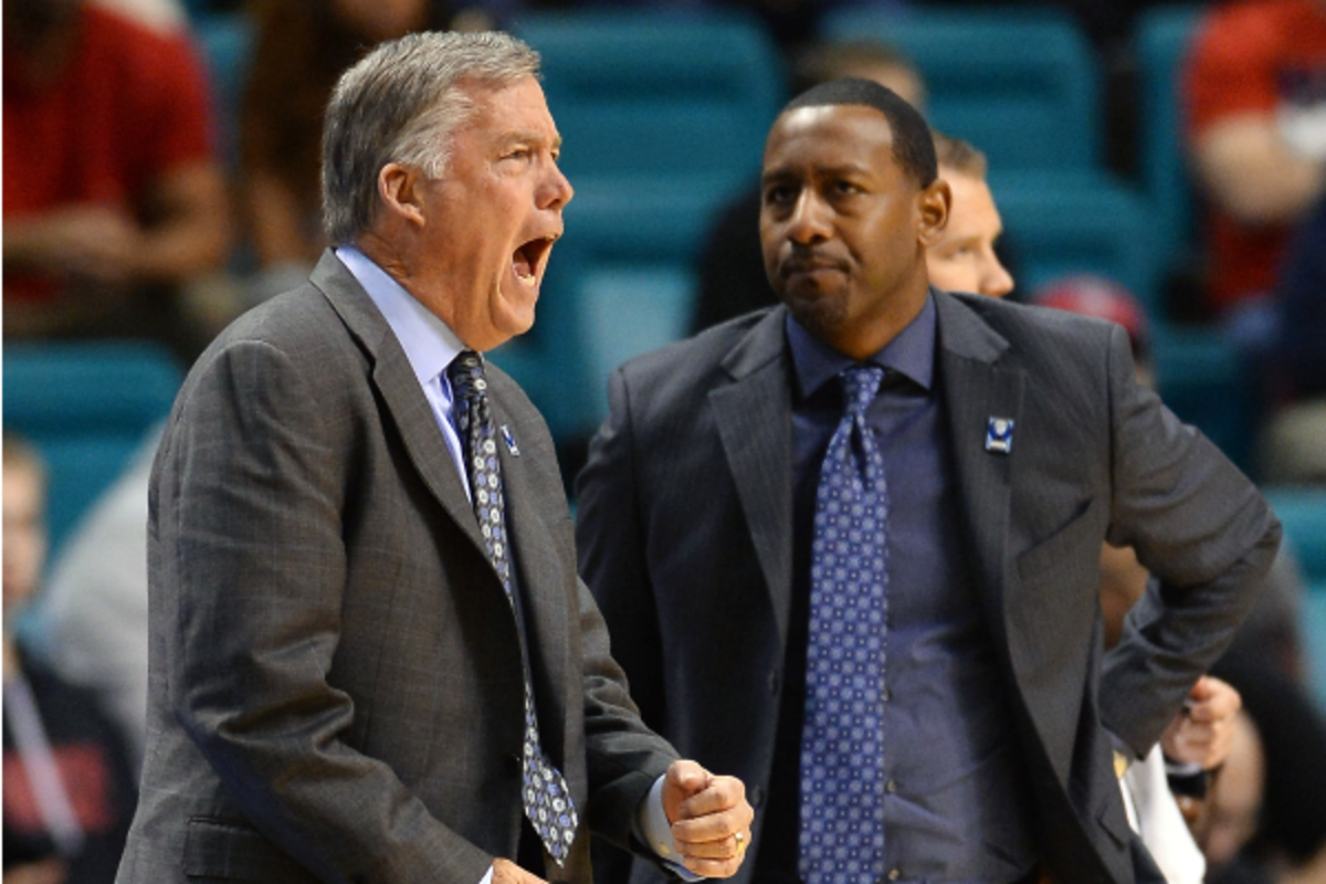Travis DeCuire (right) worked on Mike Montgomery's staff at Cal. (Ethan Miller/Getty Images)