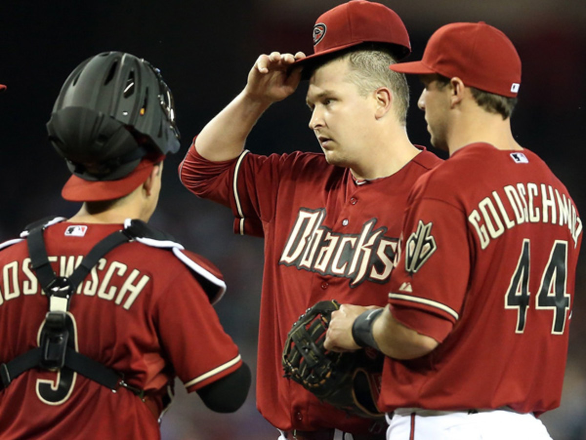 Trevor Cahill (center) has lost his starting rotation spot after a brutal first month. (Christian Petersen/Getty Images)