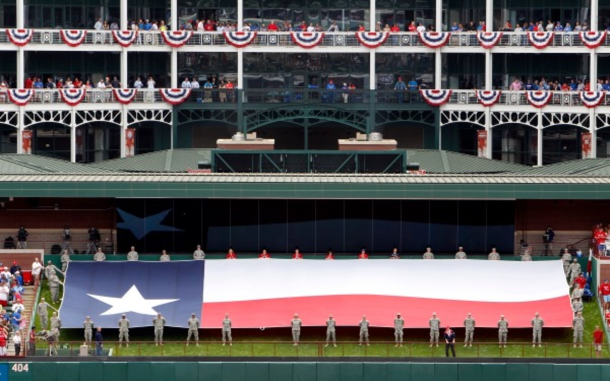 Fans watch the opening day ceremonies at the Texas Rangers home opener. (AP Photo/Tony Gutierrez)
