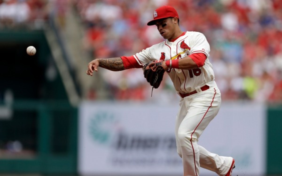 t. Louis Cardinals second baseman Kolten Wong throws to first during the second inning of a baseball game against the Chicago Cubs Saturday, April 12, 2014, in St. Louis. (AP Photo/Jeff Roberson)