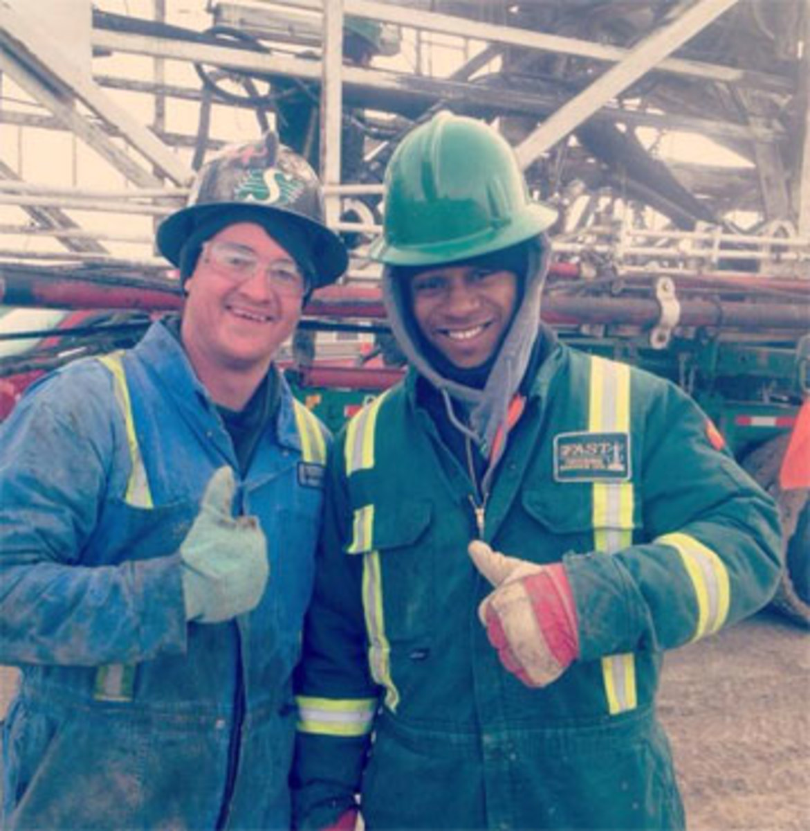 Before signing with the Raiders, ex-CFL MVP Kory Sheets (right) was working for a trucking company in Saskatchewan. (Courtesy @TheRiderman63)