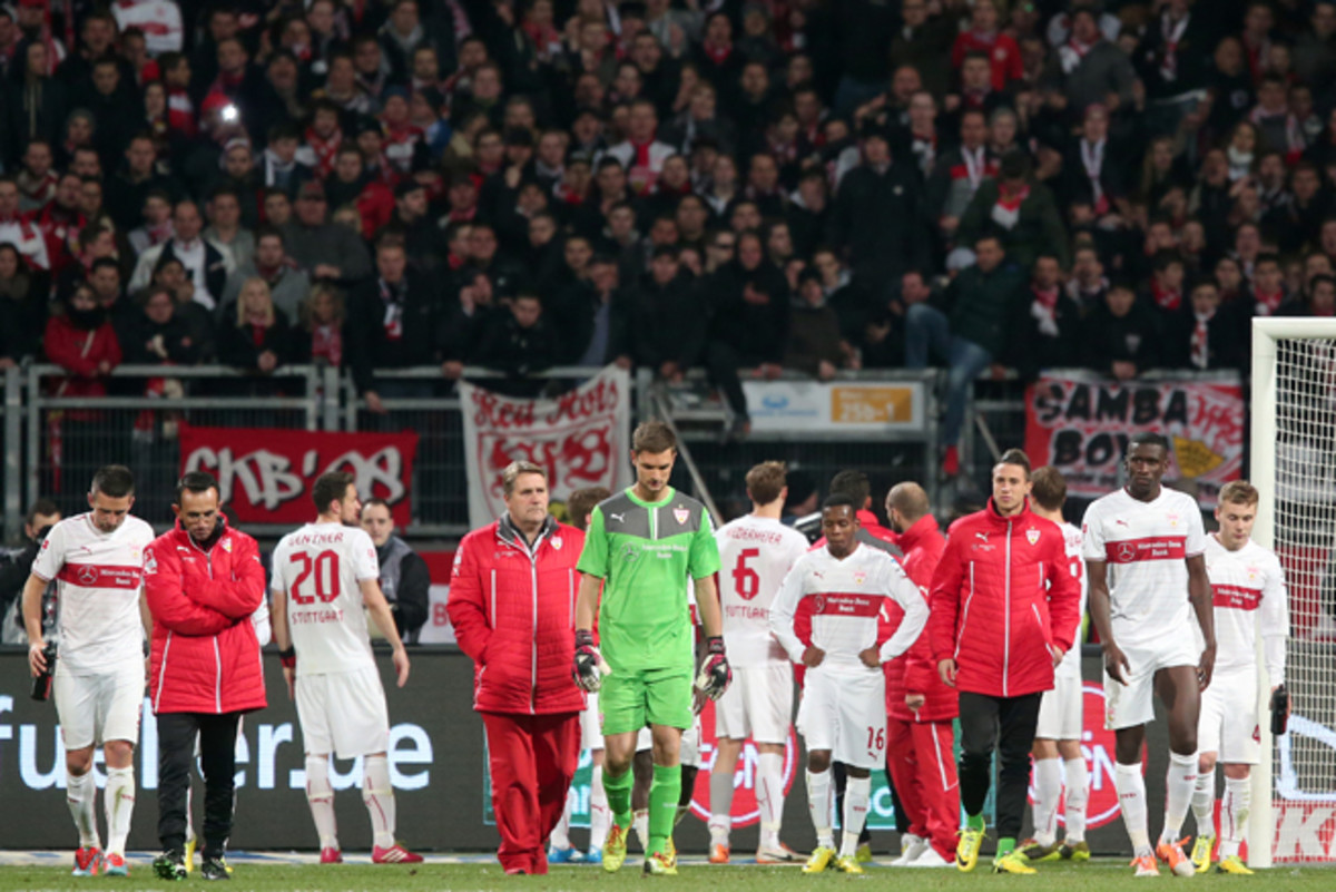 Stuttgart players walk in dejection after a loss to Nuremburg put the club in the Bundesliga relegation zone.