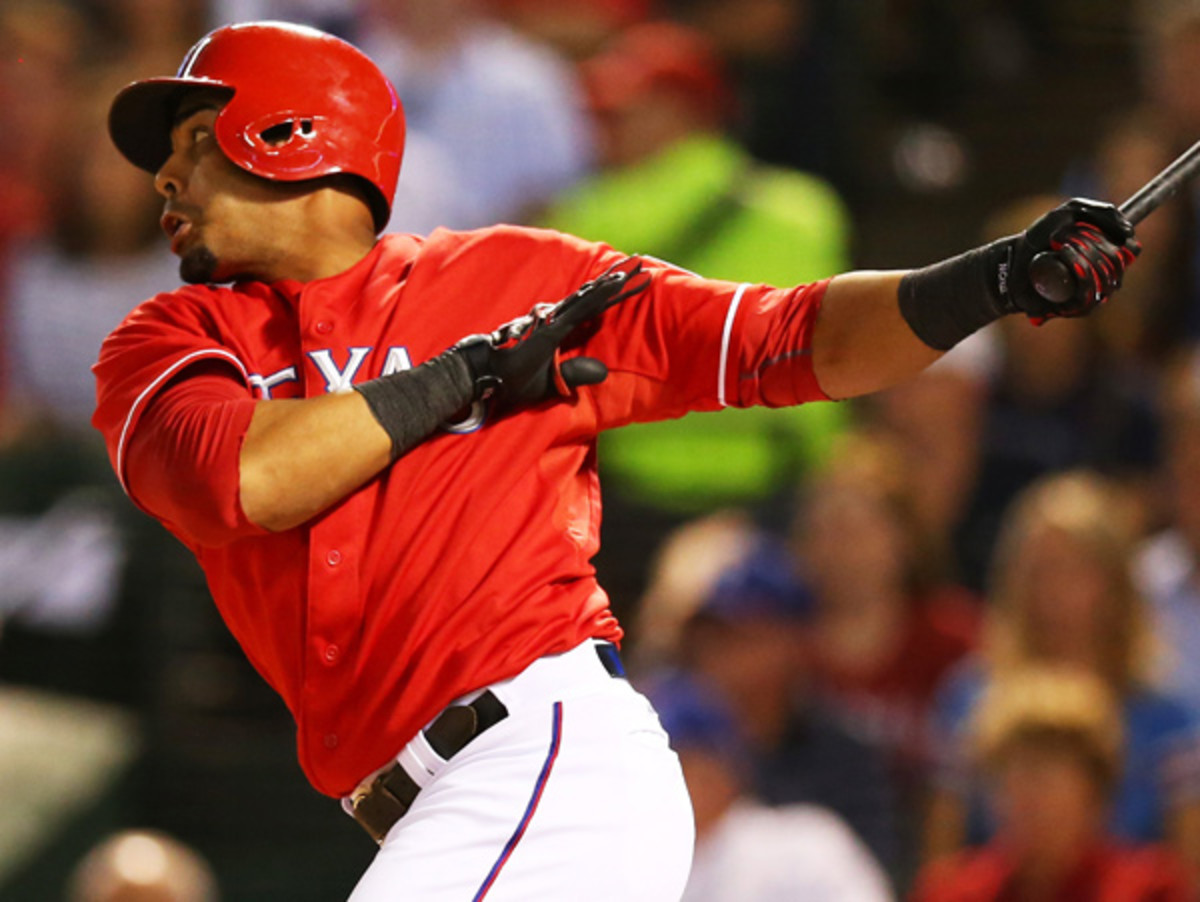 Nelson Cruz hit .266 with 27 homers and a .327 on-base percentage in his final year with Texas. (Ronald Martinez/Getty Images)