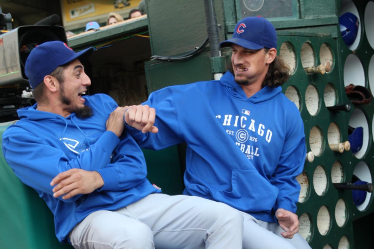 Matt Garza (left) and Jeff Samardzija (right) goofing off before a game last season. (Michael Zagaris/Getty Images)