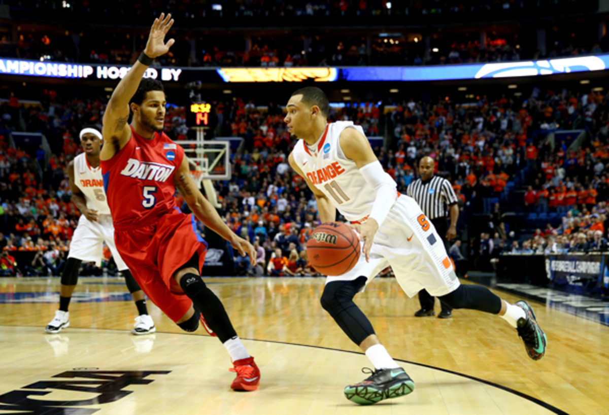 Tyler Ennis (right) plans to leave Syracuse after one season to enter the NBA draft. (Elsa/Getty Images)