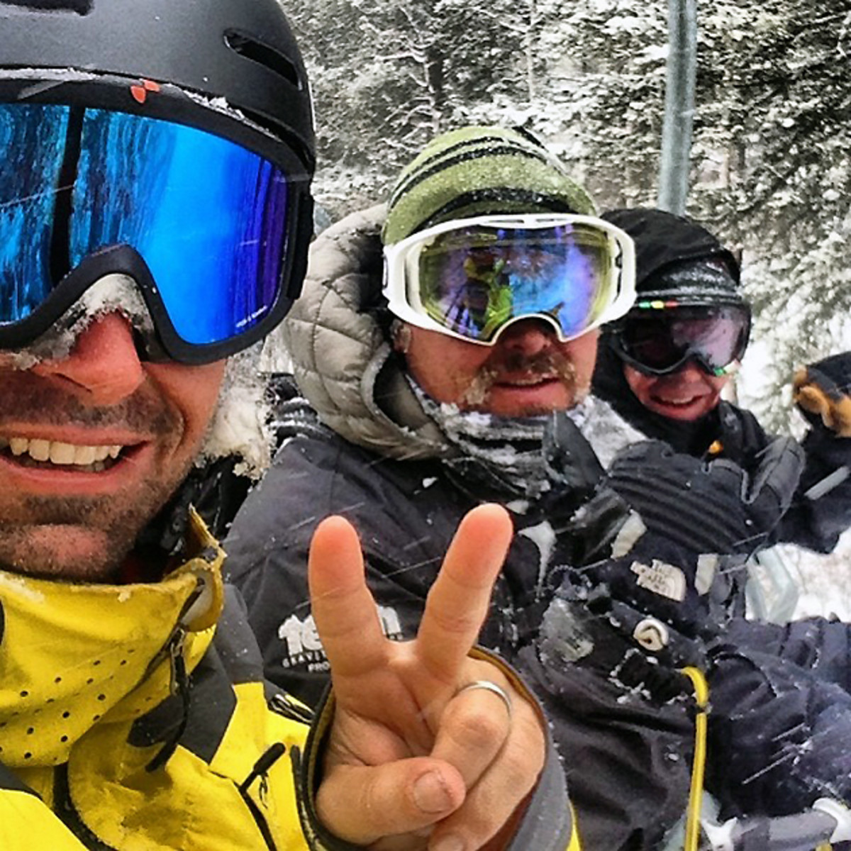 Jeremy Jones riding the chair lift with his brothers Todd and Steve.
