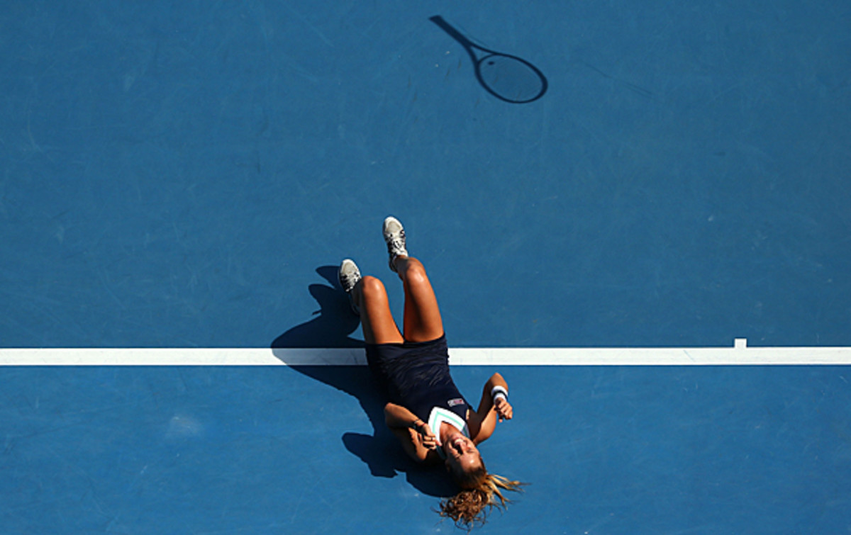 Dominika Cibulkova collapses in disbelief after reaching her first Grand Slam final. (Scott Barbour/Getty Images)