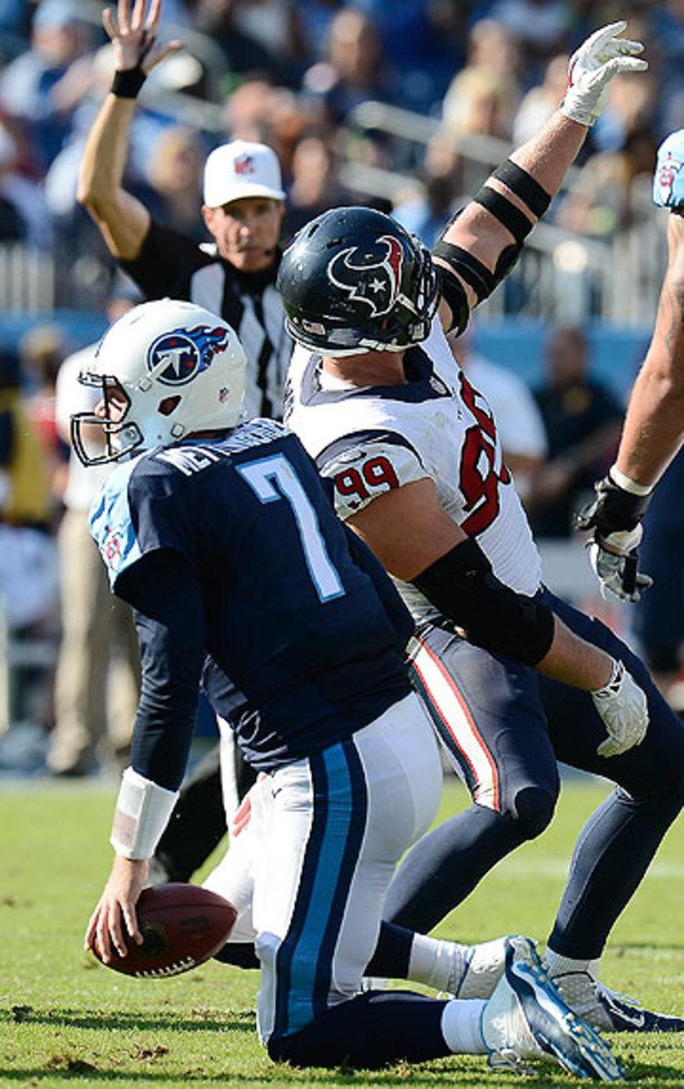 J.J. Watt mocked Zach Mettenberger by miming a selfie after sacking the Titans rookie Sunday. (Mark Zaleski/AP)
