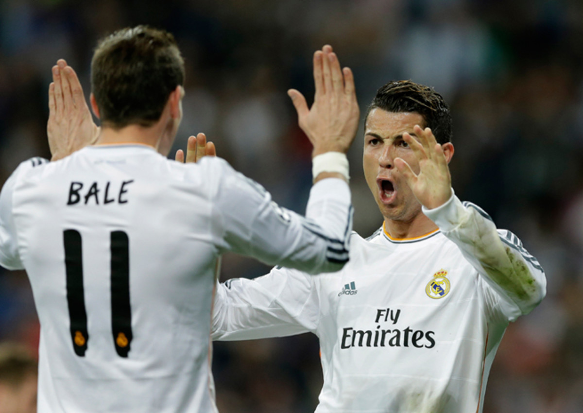Cristiano Ronaldo, right, celebrates one of his two goals for Real Madrid vs. Schalke on Tuesday with Gareth Bale, with Los Blancos cruising to the Champions League quarterfinals.