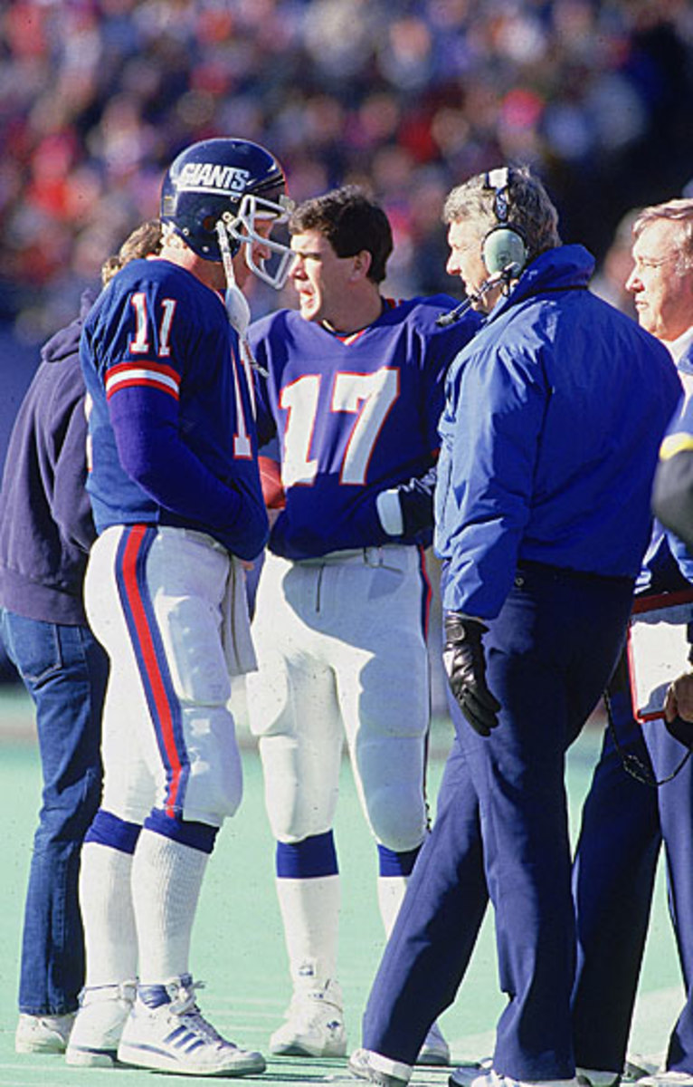 Phil Simms (l.) and Bill Parcells. (Sports Illustrated photo)