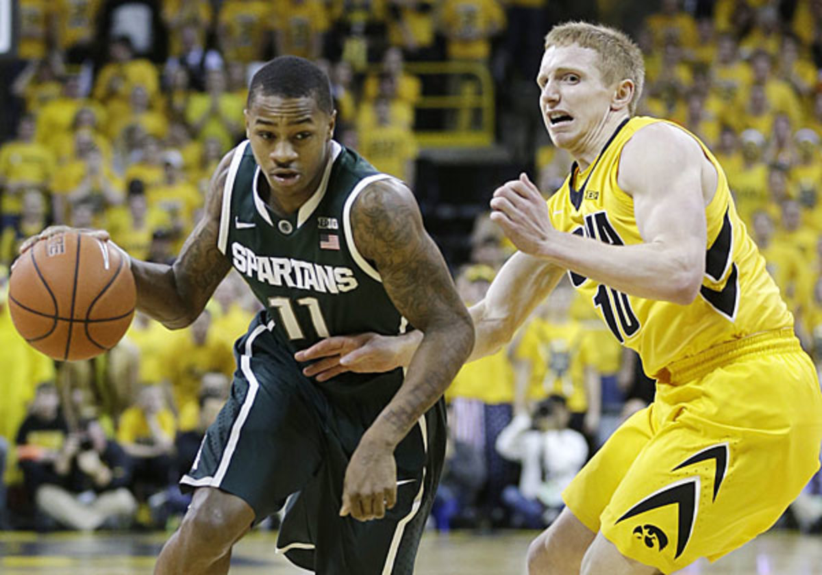 Despite playing with a variety of aches and pains, Keith Appling scored 16 in Michigan State's OT win over Iowa. (Charlie Neibergall/AP)