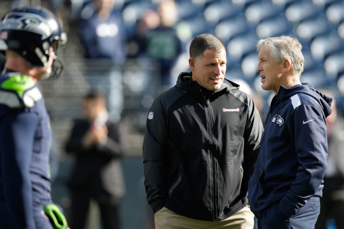 Schiano with Carroll before a game in 2013. (Elaine Thompson/AP)