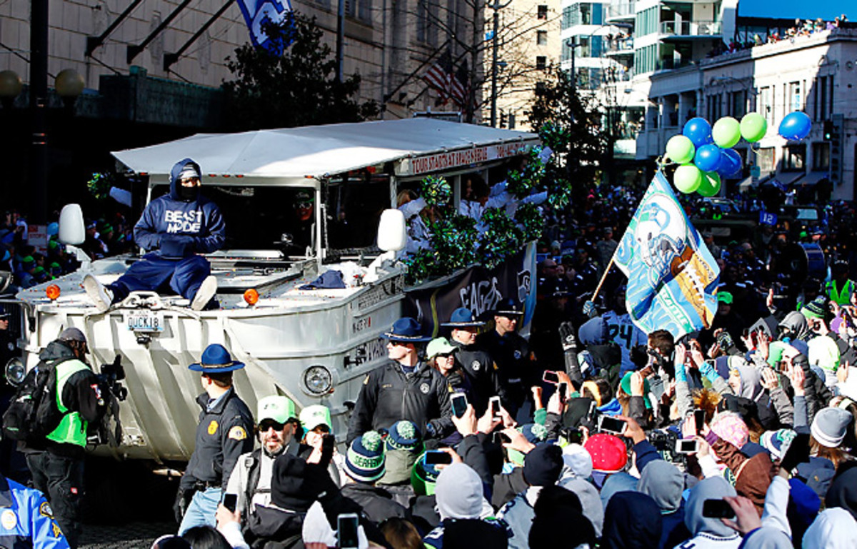 Marshawn Lynch celebrates the Seahawks' Super Bowl win in a parade through Seattle.