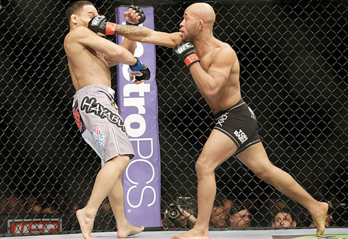Demetrious Johnson (right) has shown intriguing skills but not an ability to win overs fans.