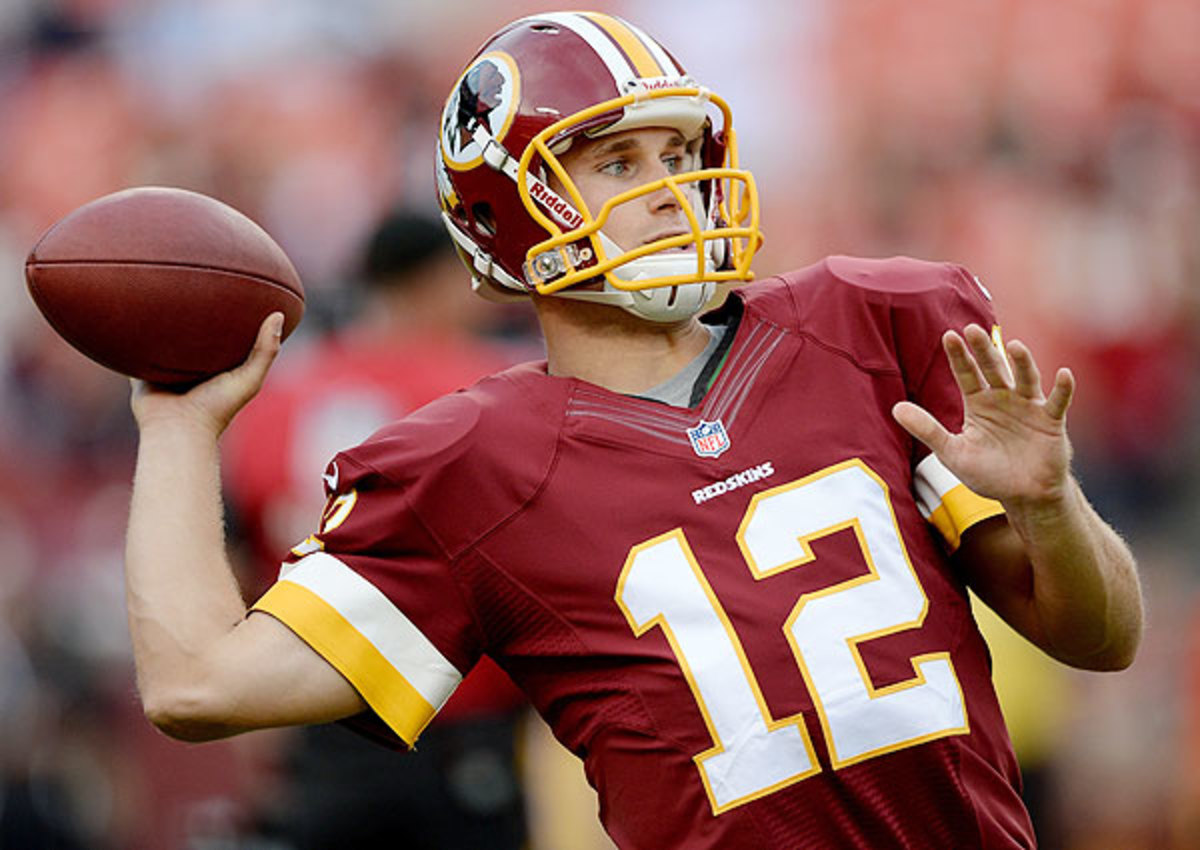 Kirk Cousins appeared in five games in 2013, throwing for 854 yards with four touchdowns and seven interceptions. (Patrick Smith/Getty Images)