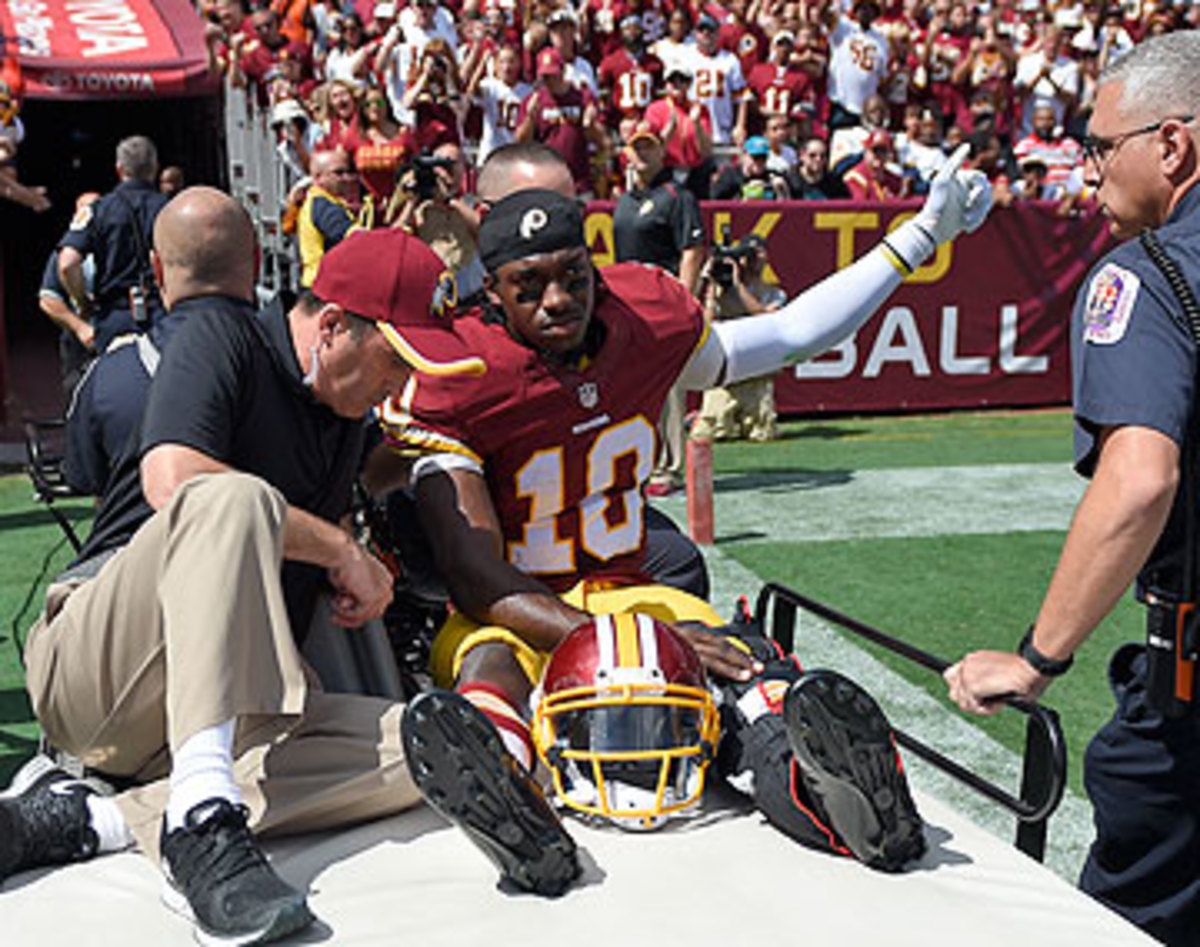 Robert Griffin III's season is in jeopardy after he dislocated his ankle on Sunday. (Nick Wass/AP)