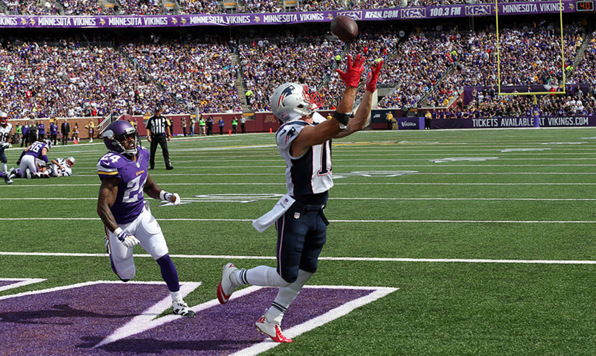Julian Edelman's touchdown catch was one of many things to like about the Patriots in their 30-7 win over the Vikings. (Jim Mone/AP)