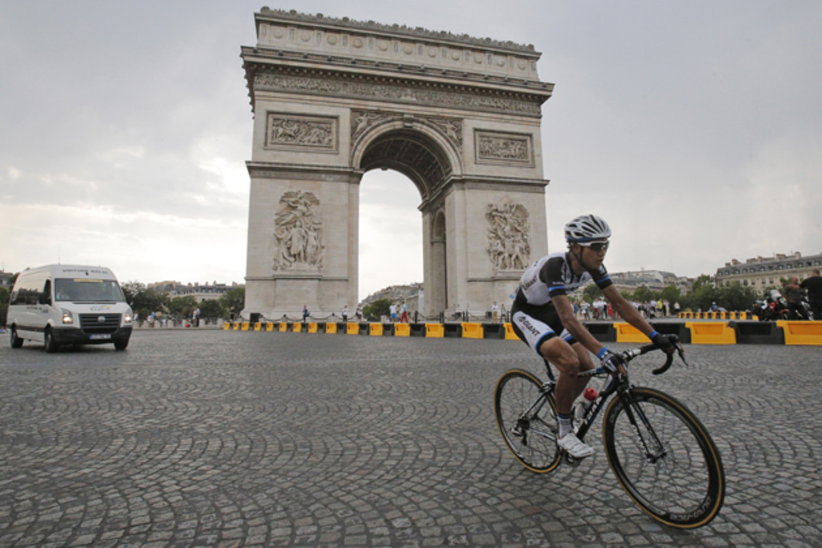 China's Cheng Ji passes the Arc de Triomphe during the twenty-first and last stage of the Tour de France.
