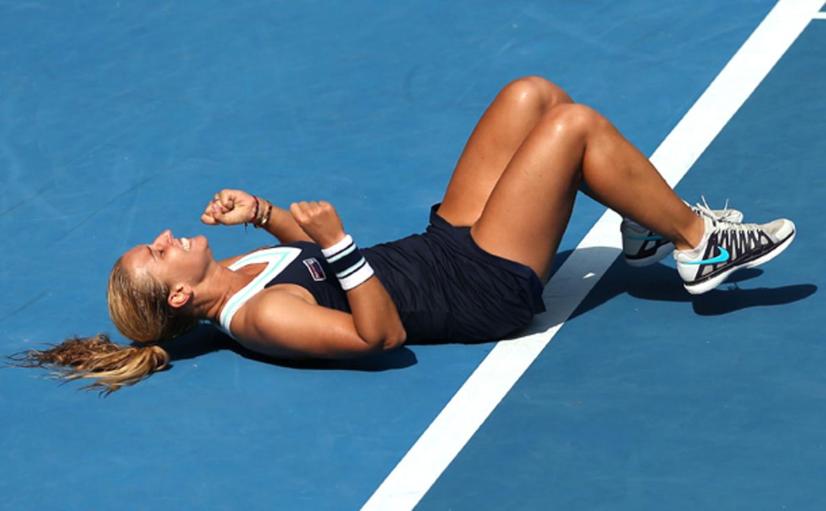 Dominika Cibulkova celebrates her victory over Agnieszka Radwanska. (Clive Brunskill/Getty Images)