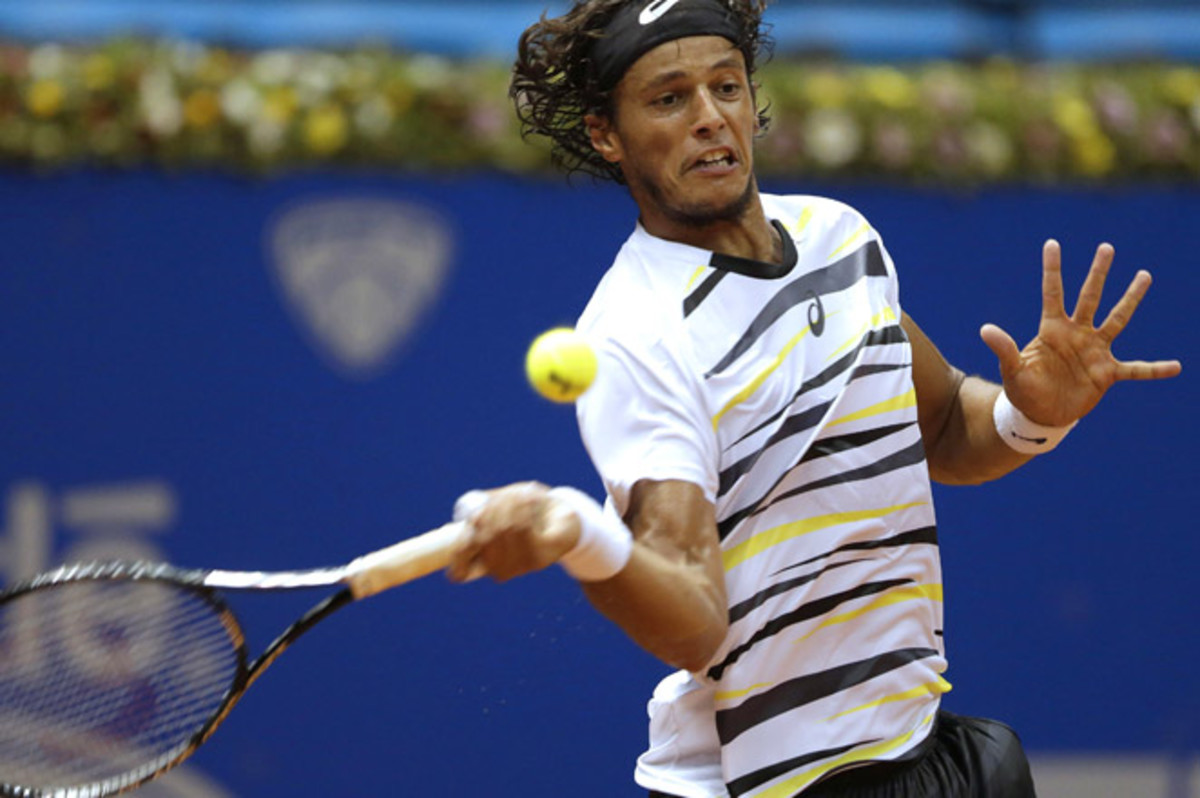 Wild-card Joao Souza advanced into the second round at the Brazil Open in his first win of the year.