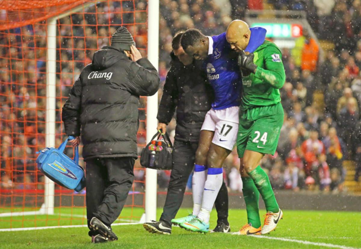 U.S. goalkeeper Tim Howard (24) helps injured striker Romelu Lukaku off the field during Everton's 4-0 loss to rival Liverpool Tuesday.