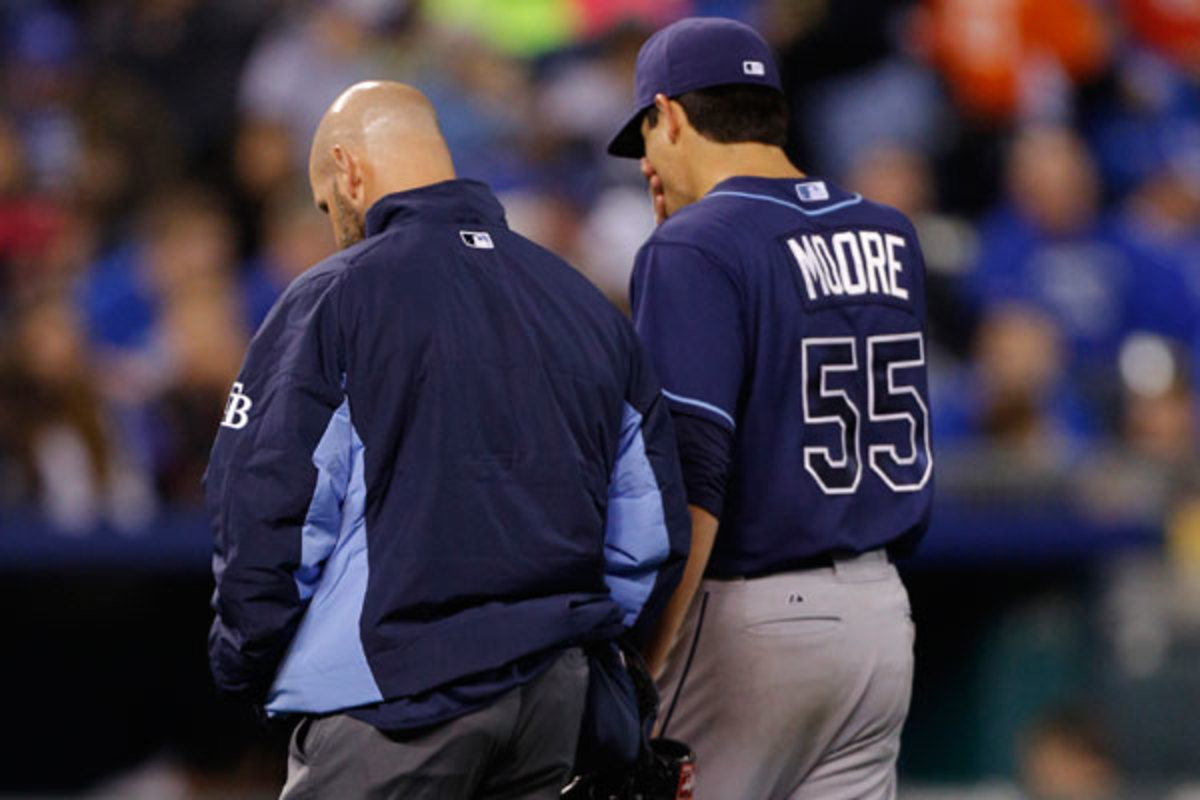 Matt Moore leaves the field after he injured himself ls in the fifth inning Monday night. (Photo by Ed Zurga/Getty Images)