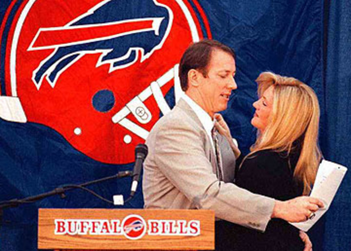 Jim Kelly retired from the NFL in January 1997 with his wife Jill by his side. (Wayne Scarberry/Getty Images)