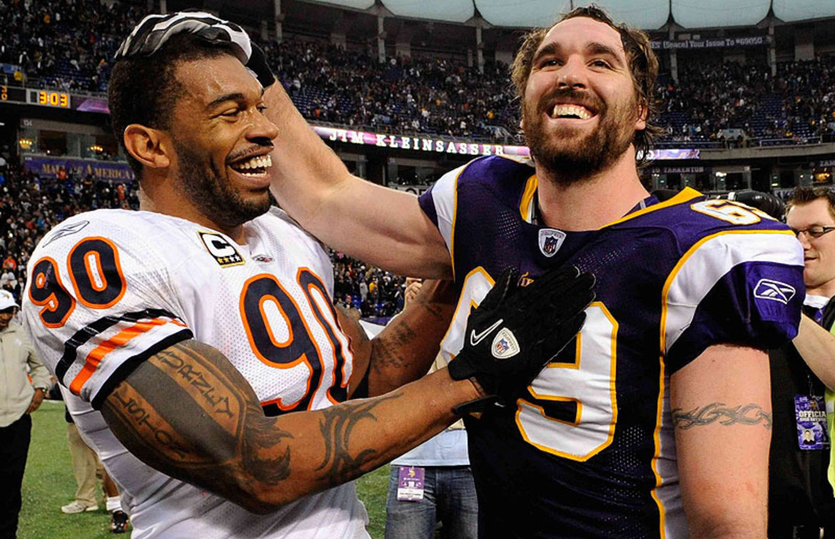 Julius Peppers and Jared Allen each signed with new NFC North teams this offseason: Peppers is now a Packer, and Allen is now a Bear. (Hannah Folsein/Getty Images)