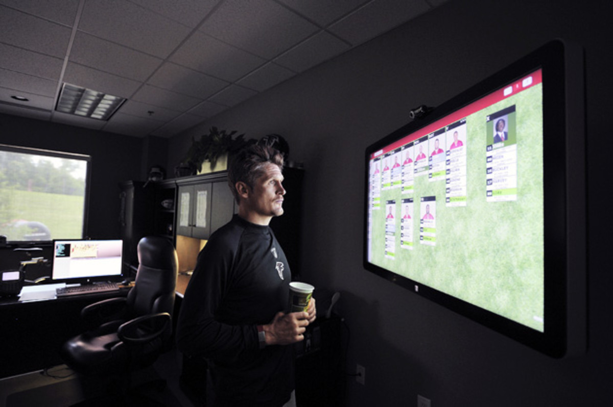 Dimitroff looks over the team's depth chart during training camp at Falcons' headquarters.