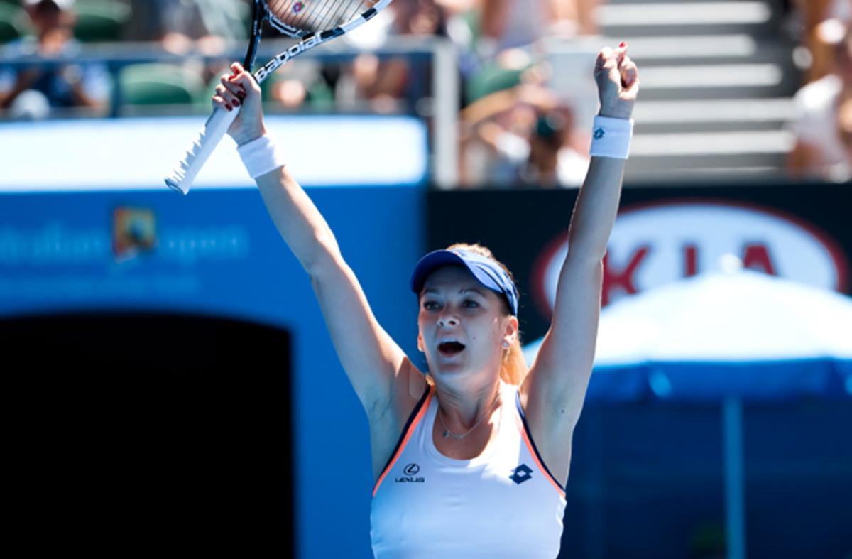 Agnieszka Radwanska celebrates her three-set victory. (Sydney Low/AP)