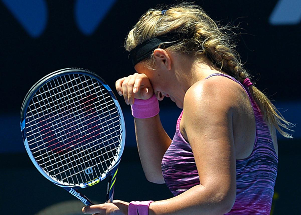 Victoria Azarenka couldn't figure out how to get past Agnieszka Radwanska in the quarterfinals. (Paul Crock/AFP/Getty Images)