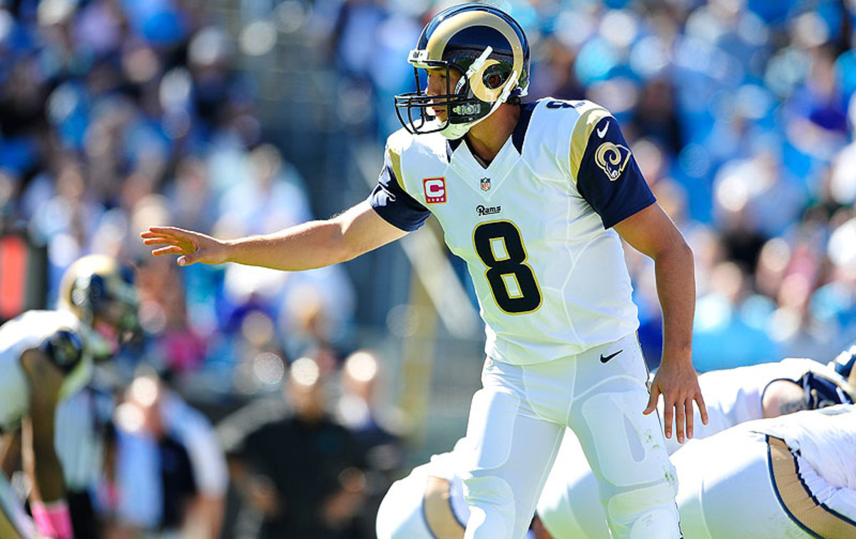 Four years after being the No. 1 overall pick, Sam Bradford might be looking over his shoulder in St. Louis this fall. (Grant Halverson/Getty Images)