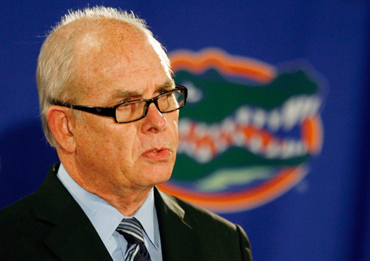 Univ. of Florida president Bernie Machen said athletic departments are between 'a rock and a hard place.'