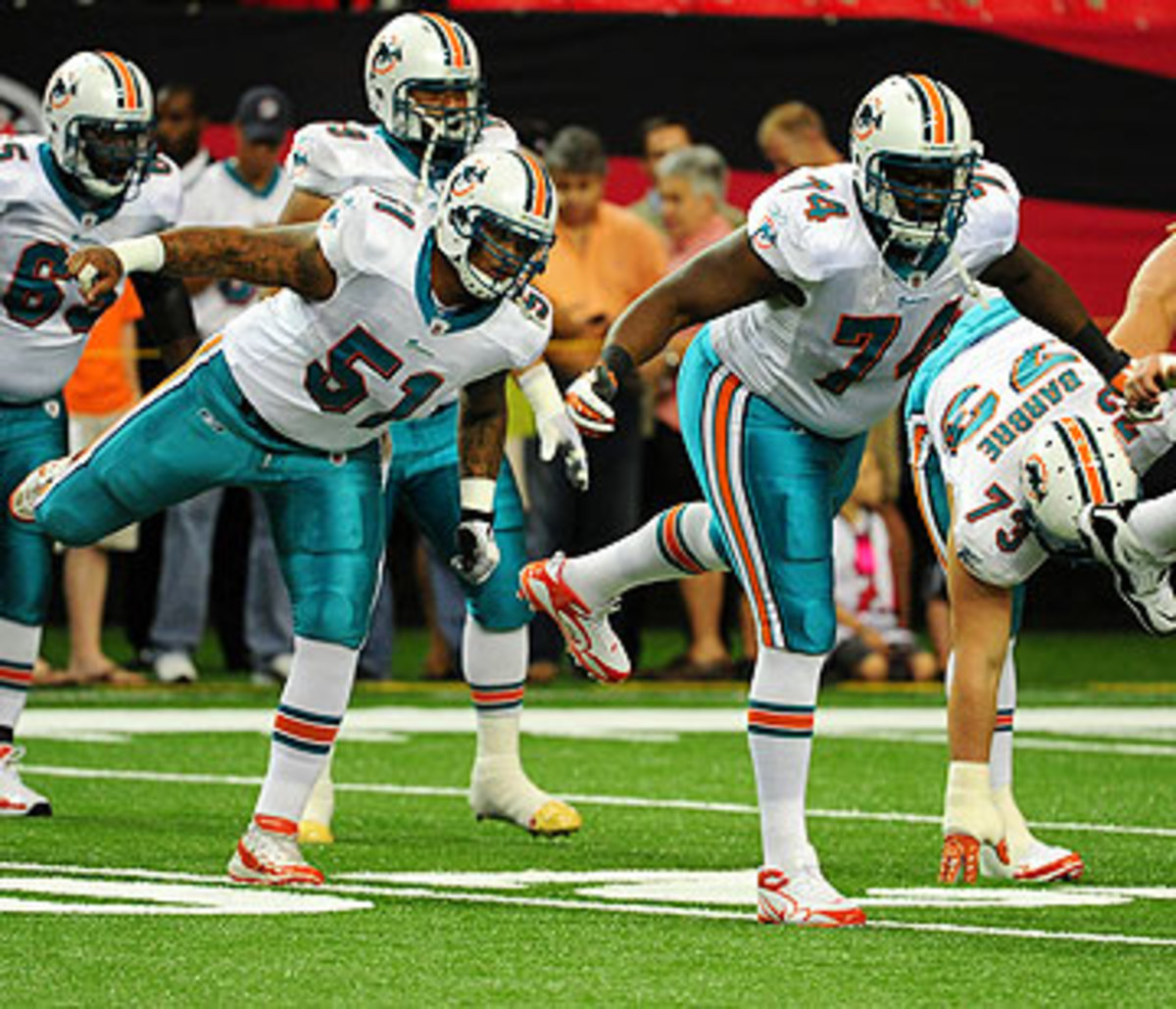 Mike Pouncey (51) and John Jerry (74) likely will be facing punishment from the NFL for their roles in the harassment of Jonathan Martin. (Scott Cunningham/Getty Images)