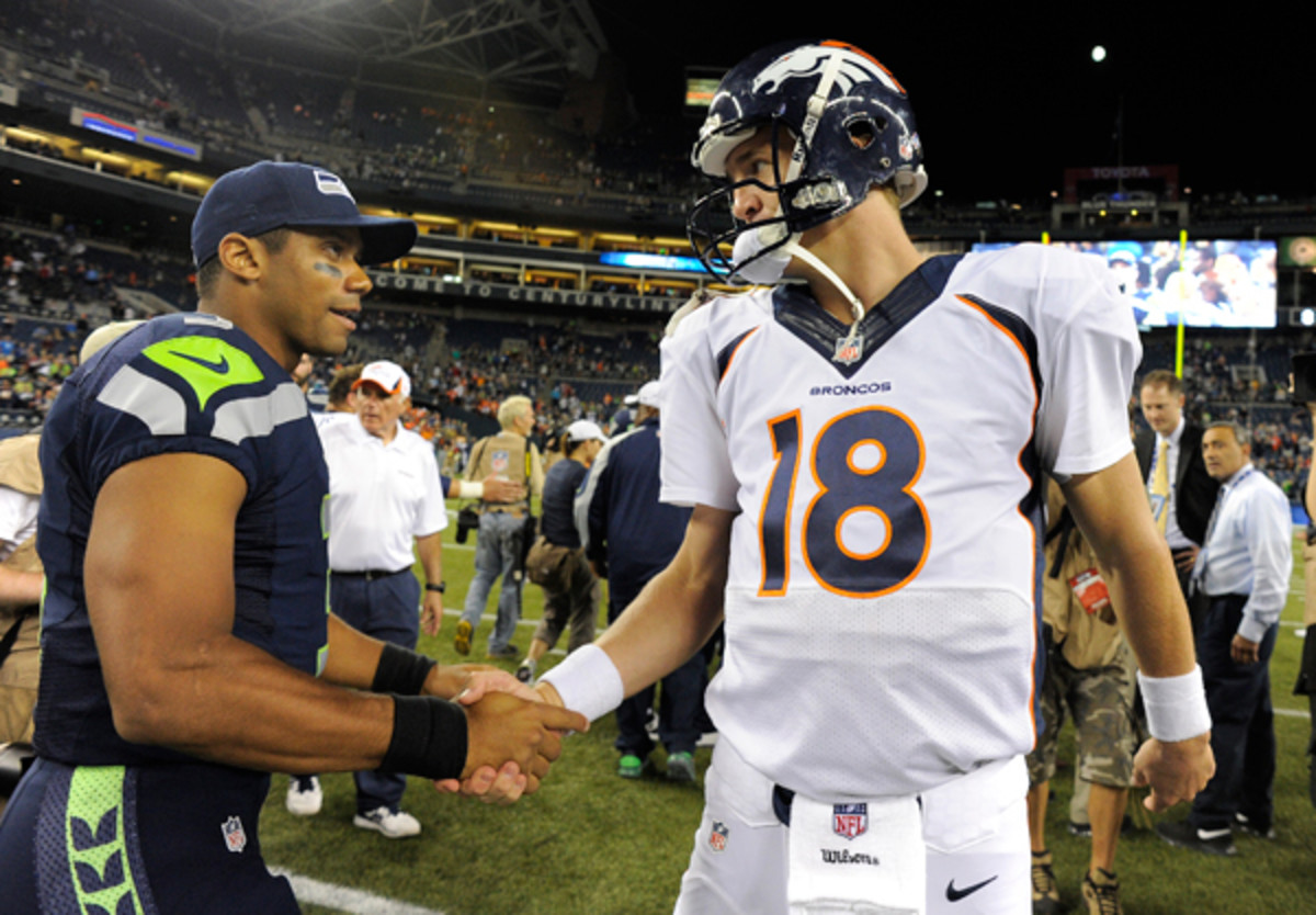 Russell Wilson kisses the ring after Seattle's 40-10 preseason win over Peyton Manning's Broncos in Aug., 2013.