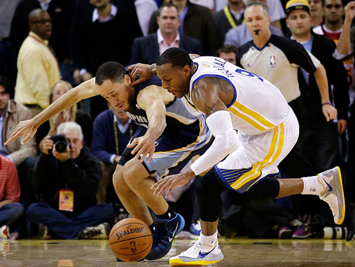 Andre Iguodala (right) helps the Warriors in ways that aren't showcased in the box score.