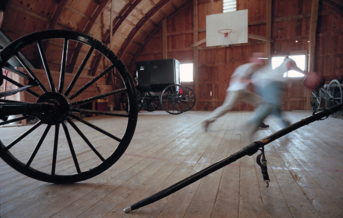 Kevin and Nevin Mishler, who played on Reese's title team, still go one-on-one in the barn where they honed their games.