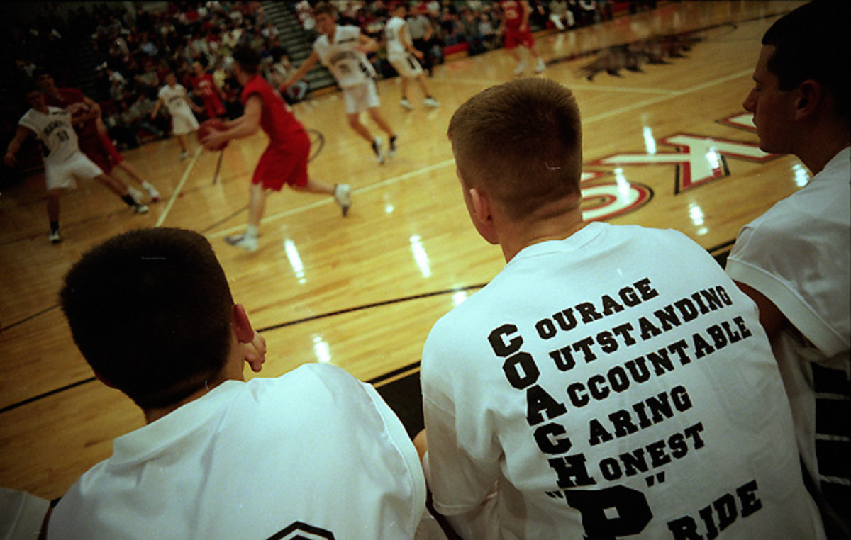 Players on the Hiland bench wear reminders of Reese's teachings on their backs during games.