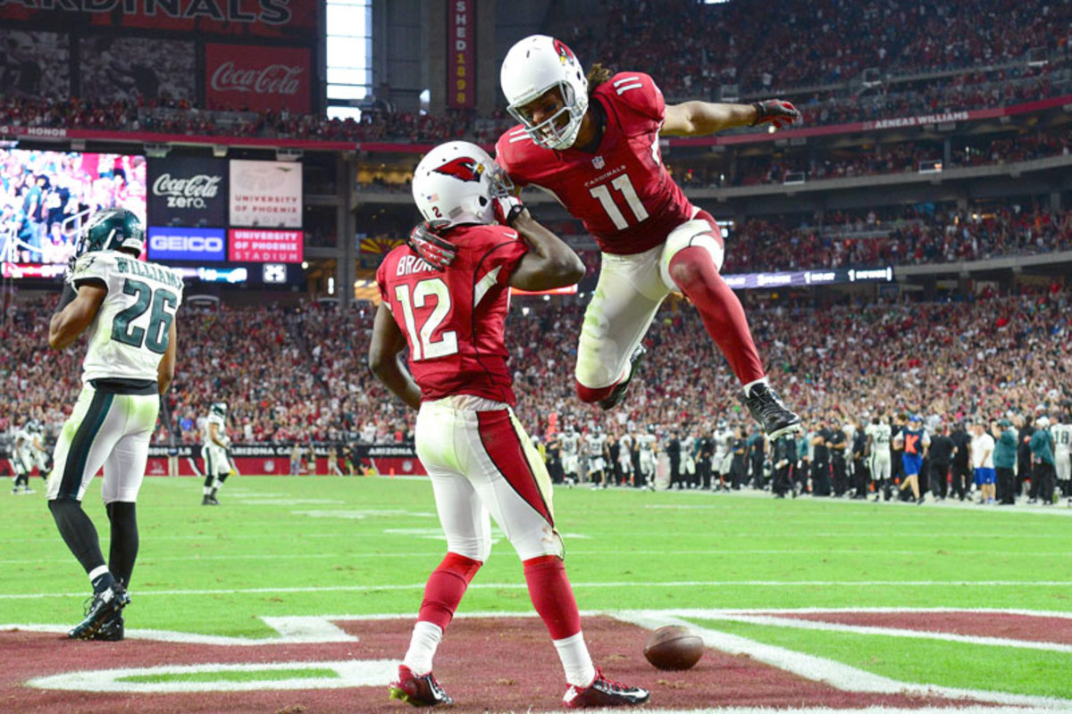 Brown (12) told the Cards brass he'd follow and learn from Fitzgerald (11), but against Philly it was the veteran who was thrilled by the rookie. (John Biever/SI/The MMQB)