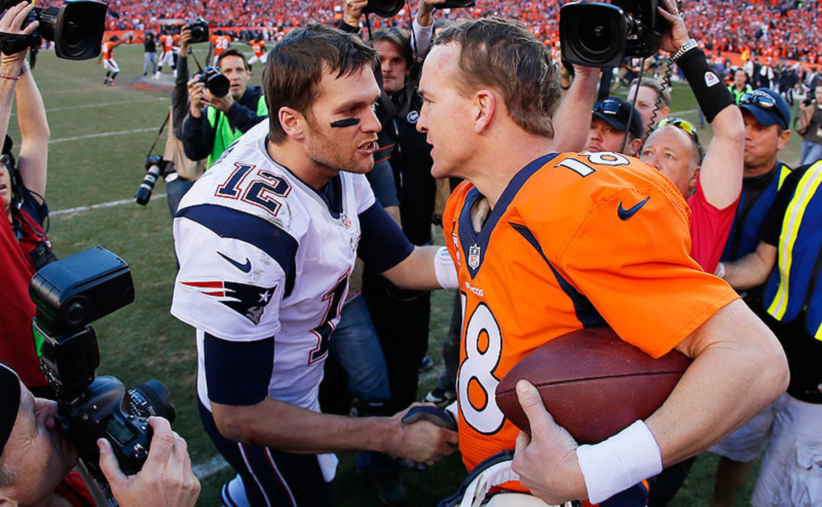 Peyton Manning got the better of Tom Brady last season in the AFC title game. (Kevin C. Cox/Getty Images)