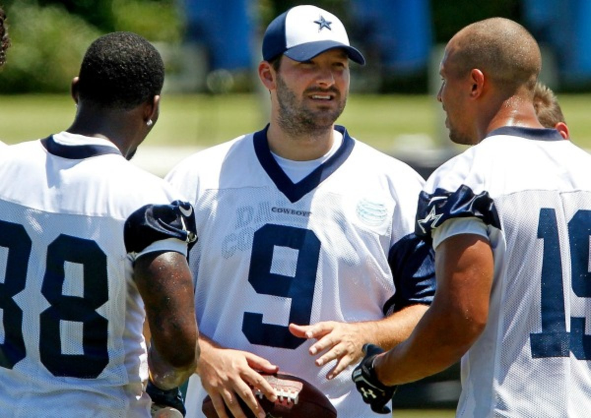Tony Romo was limited to walk-throughs and light throwing after offseason surgery. (Getty Images)