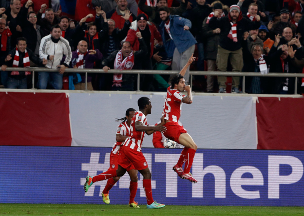 """Alejandro """"Chori"""" Dominguez, right, celebrates his opening goal in Olympiakos' 2-0 victory over Manchester United in the Champions League on Tuesday."""
