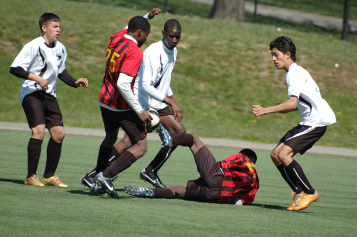 Bakary (center) and South Bronx United play against the Rosedale Rockets in the Icahn Stadium on Randall's Island in 2012.
