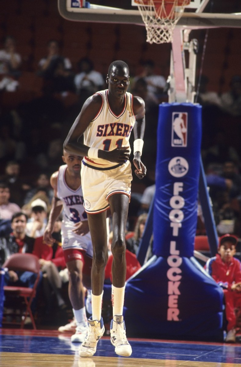 Philadelphia 76ers Manute Bol (11) in action vs Indiana Pacers.