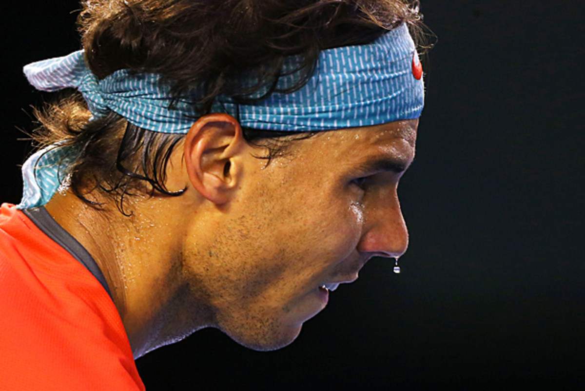 It's quite cool outside in Melbourne, but of course Rafael Nadal is dripping sweat. (Quinn Rooney/Getty Images)