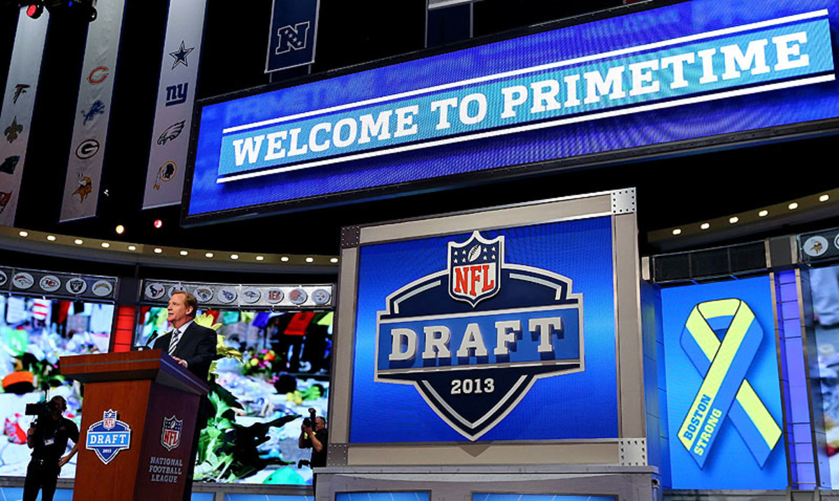 The NFL draft used to be two days—on a Saturday and Sunday—before moving to the current three-day format, including two nights in primetime, in 2010. (Al Bello/Getty Images)